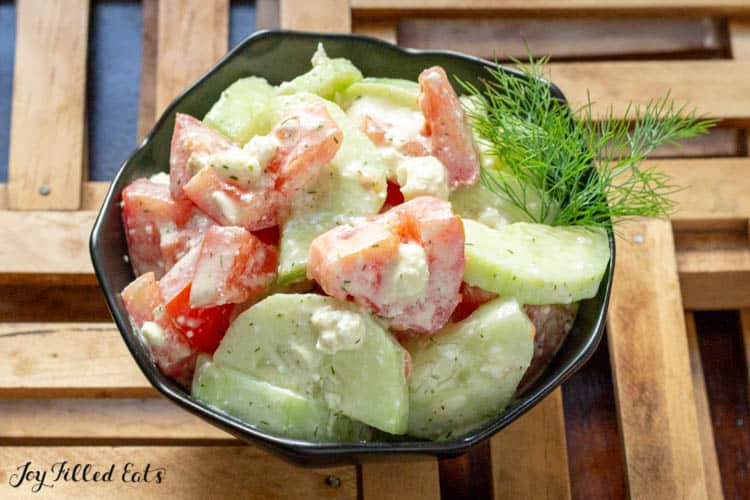 a bowl with tomato cucumber salad with feta