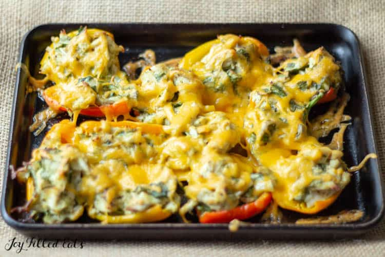 baked stuffed peppers on a stoneware tray
