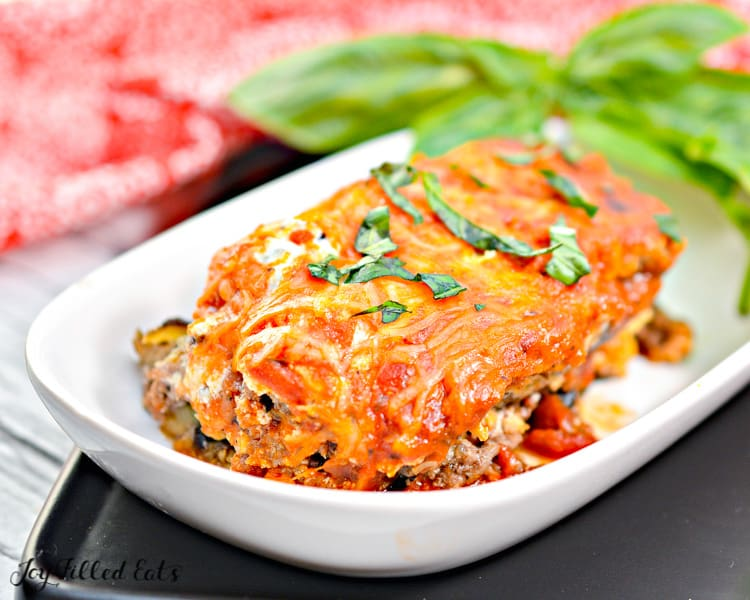 a plate with eggplant lasagna topped with basil