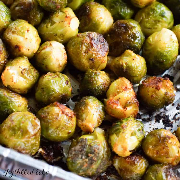 grilled brussel sprouts in a foil tray