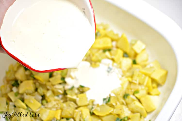 a small bowl with cream poured over the cooked yellow squash
