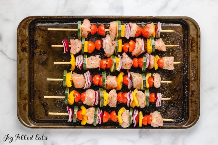 chicken and vegetables on wood skewers