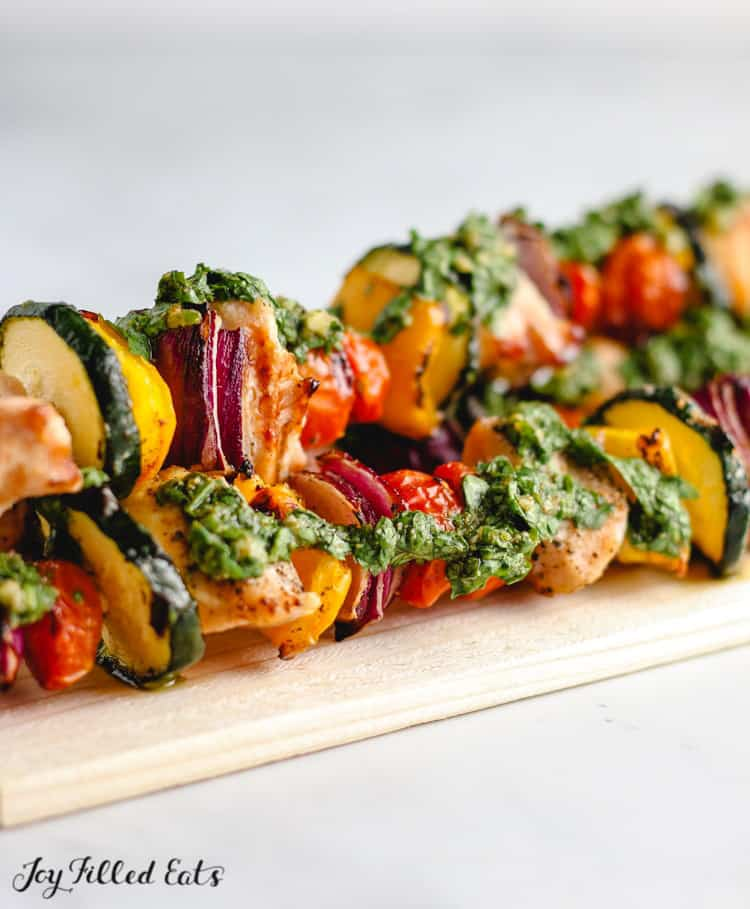 close up of chimichurri chicken vegetable skewers