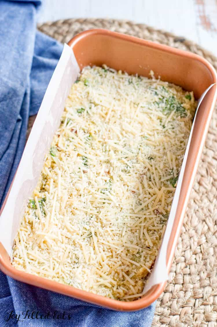 breakfast bread batter in a loaf pan with parchment