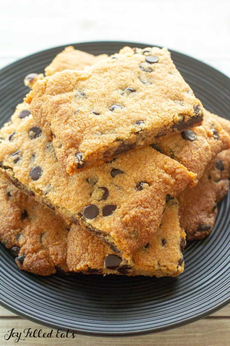 plate with a stack of cookie bars with chocolate chips