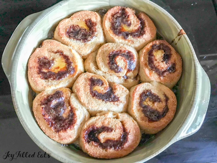 baked pumpkin cinnamon rolls in a baking dish