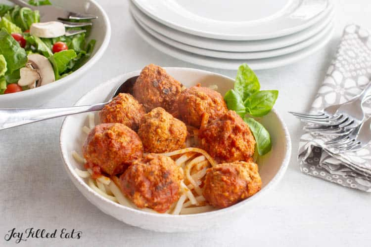 Instant Pot Meatballs with heart of palm noodles in a white bowl