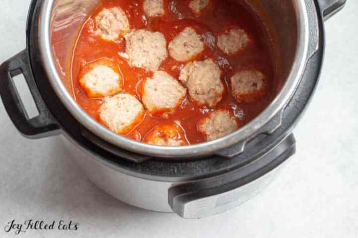 raw meatballs in sauce in the instant pot