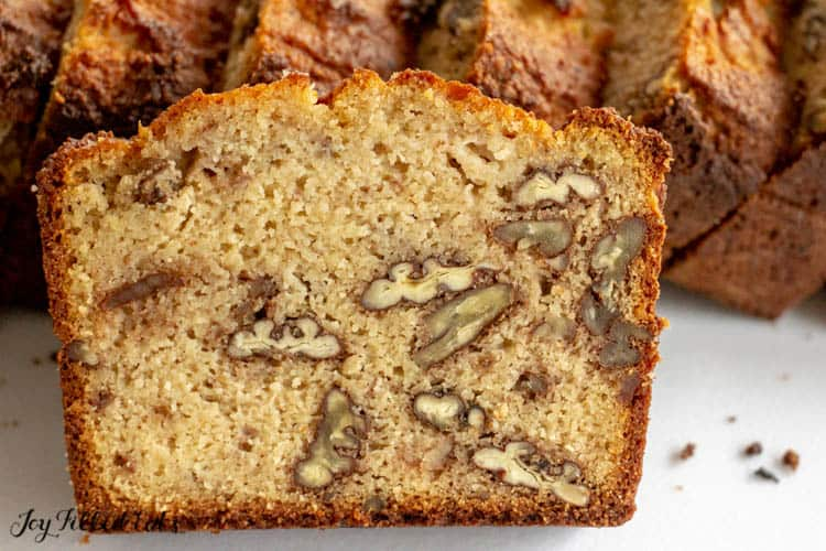 close up of the crumb inside a piece of keto banana bread with nuts