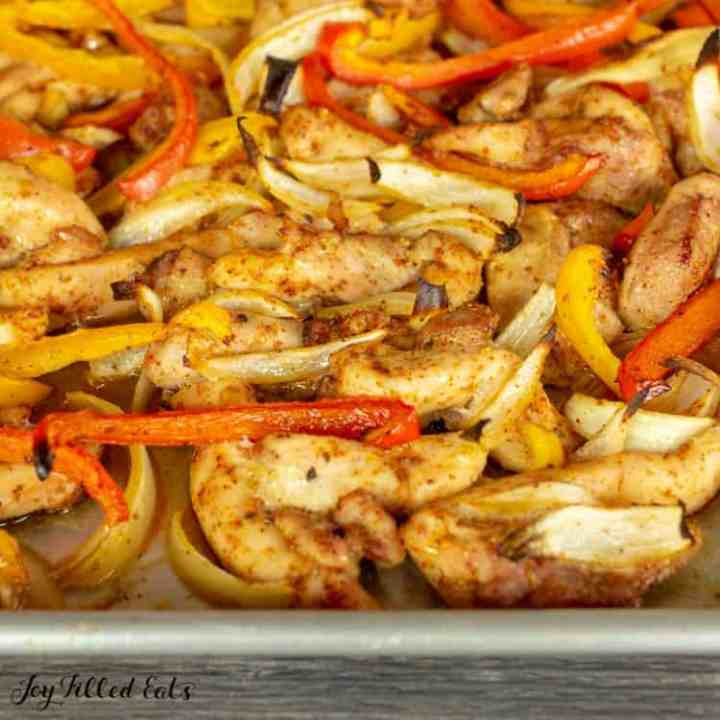 close up of the cooked chicken peppers and onions