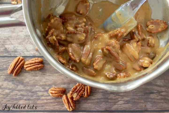 saucepan with pecans and caramel