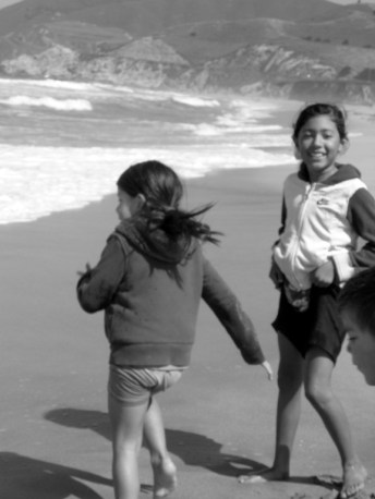 littles running from the waves