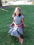 SCHOOL ella smililing sitting on chair full body julia 58