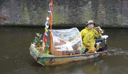 I met the extraordinary poet-musician of the Amsterdam canals