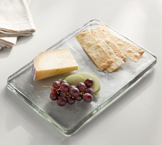 Glass serving board with cheese and crackers