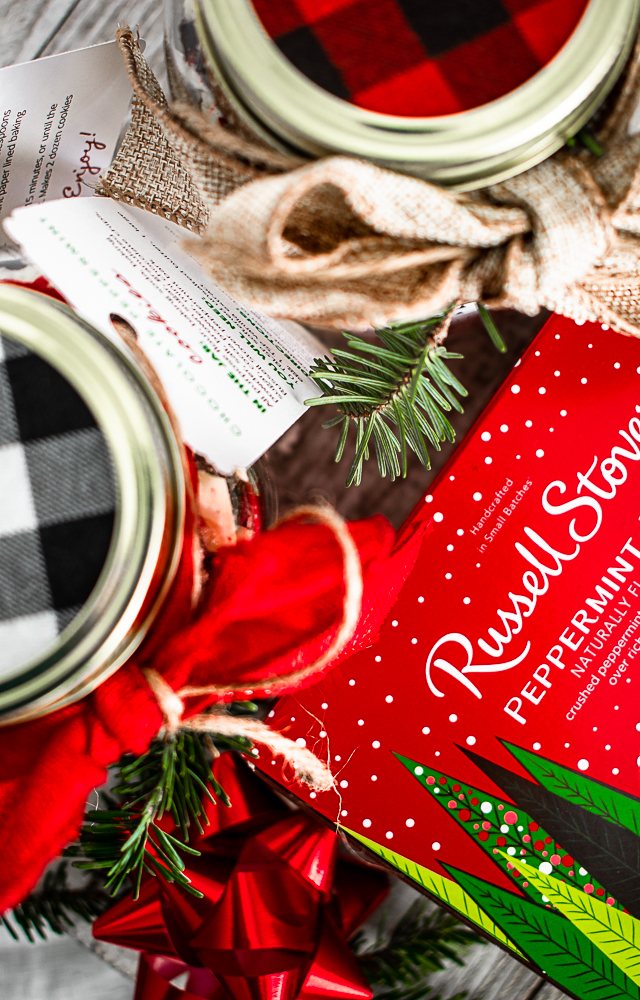 A box of Russell Stover peppermint bark next to Christmas gifts in jars