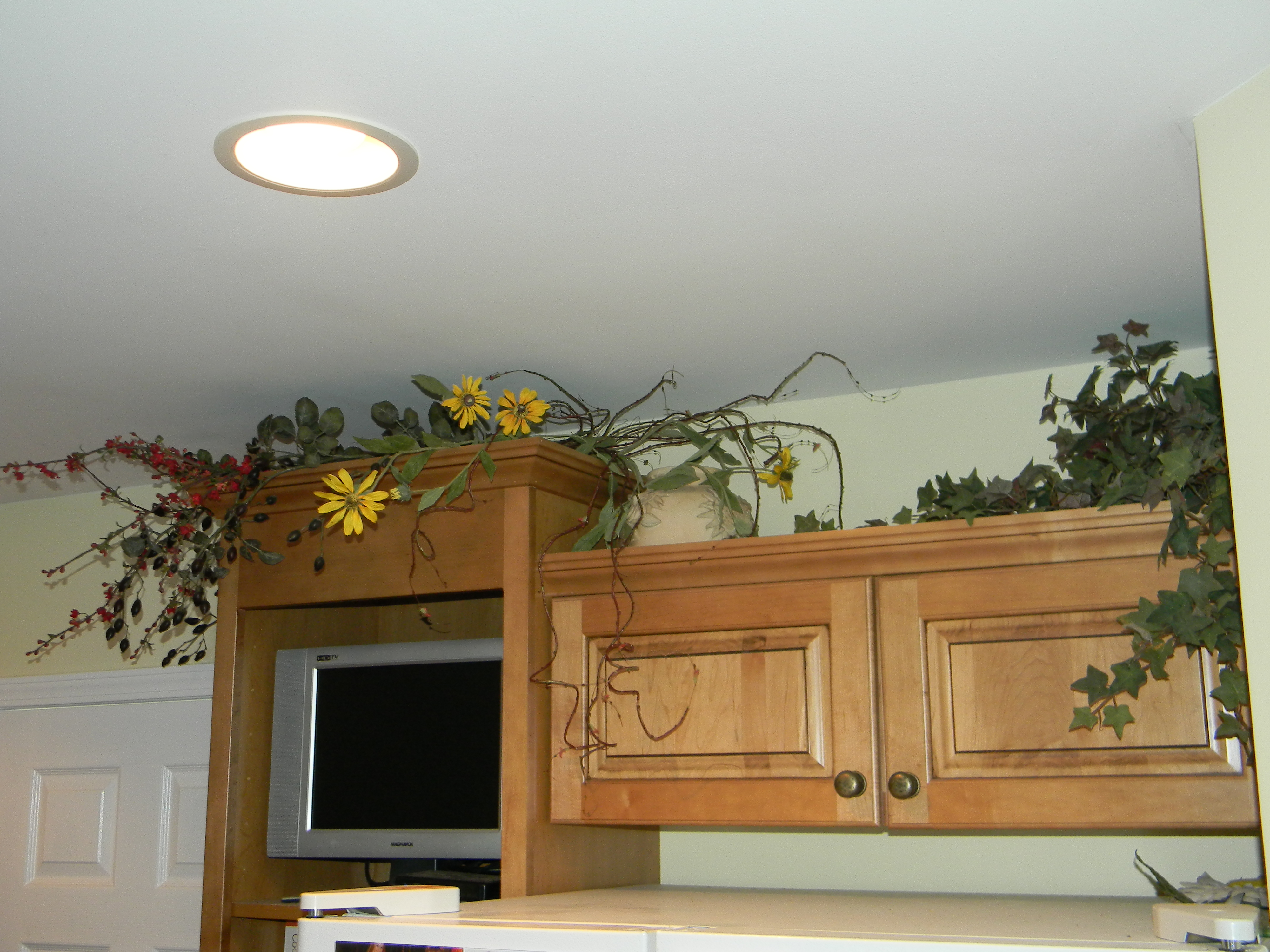 The Worst Mistake People Make When Placing Under Counter: Decorating Above Kitchen Cabinets, Above Fridgerator