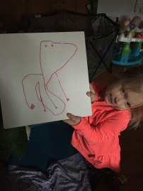 KS drawing a giraffe!
