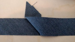 Fold the top strip at 45 and press