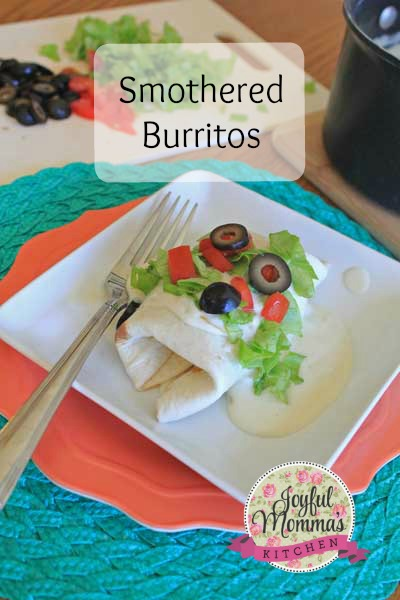 Take your fiesta to another level by smothering these beef and bean burritos in a sour cream and green chili sauce.