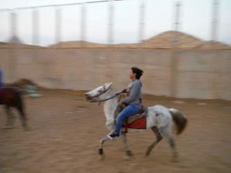 This is the only girl in a group of young locals going out to ride in the desert!!!