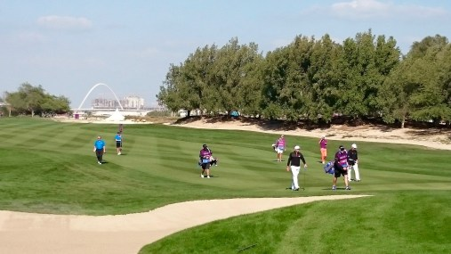 Neat shot of the Arch as the players make their way along the fairway.