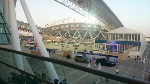 Walking from the indoor arena along the pedestrian bridge