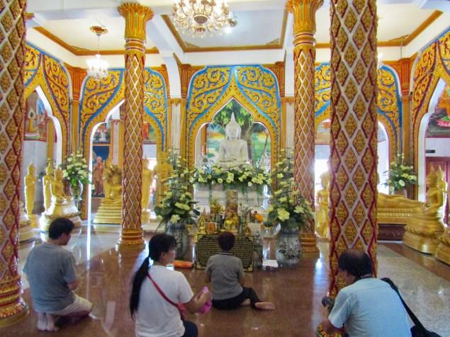 Visitors praying to Buddha..