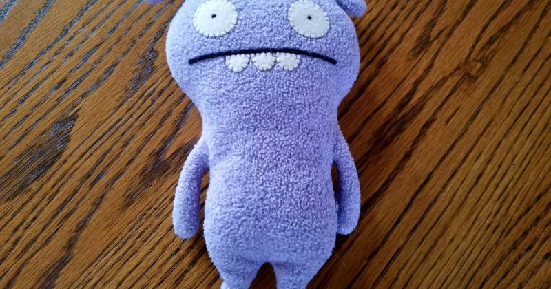 purple stuffed animal with a nervous expression