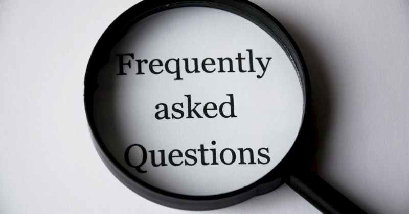 black magnifying glass over the words frequently asked questions FAQs