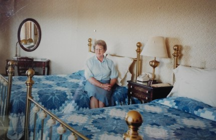 Mom matches the hand-made quilts.