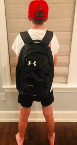 Child wearing a backpack properly.