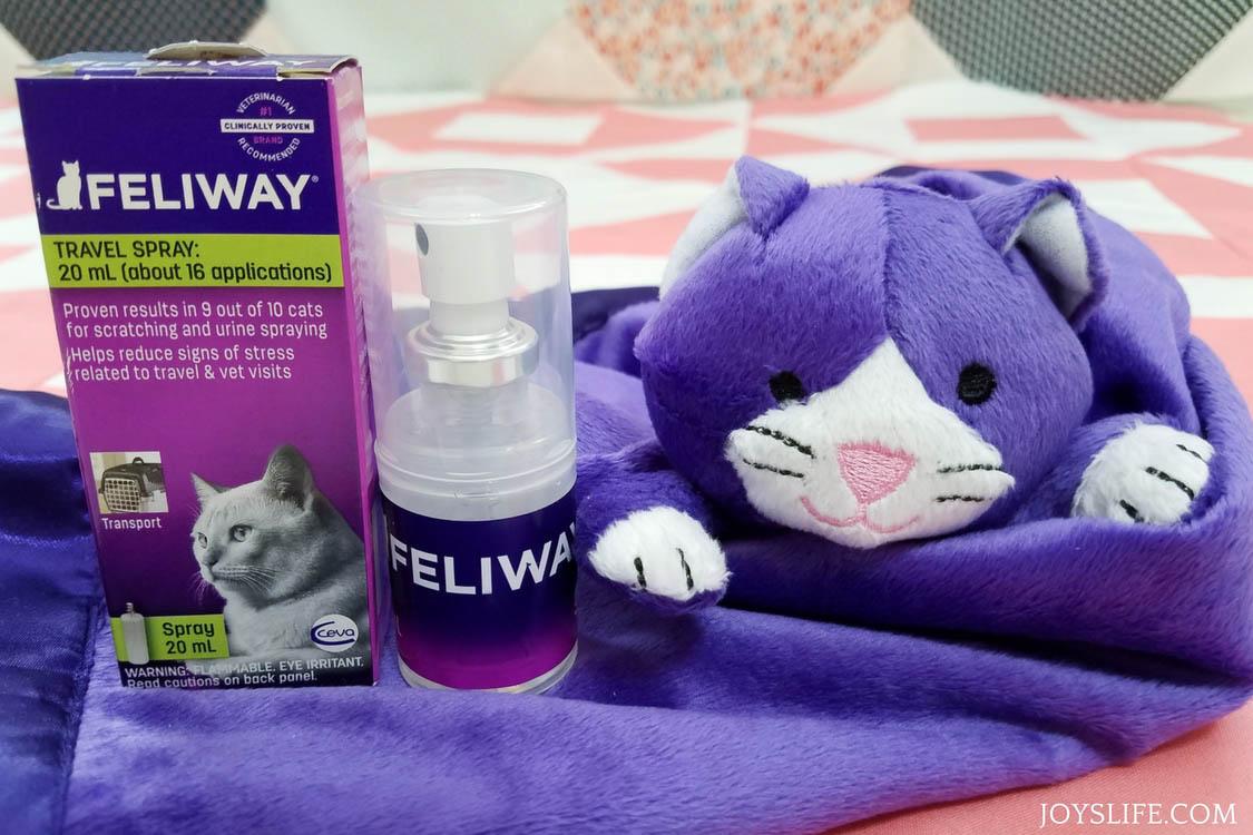 feliway travel spray and purple cat blanket