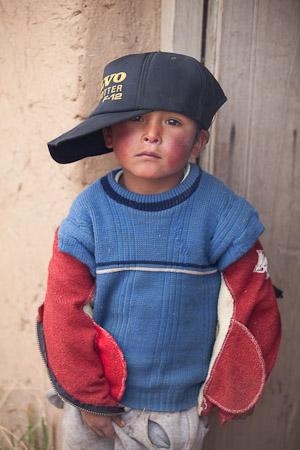 Bolivian boy in baseball cap