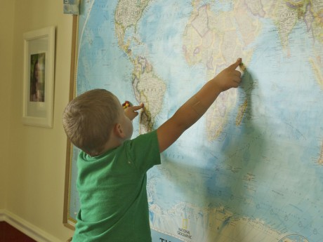 son pointing to east africa and bolivia on a world map