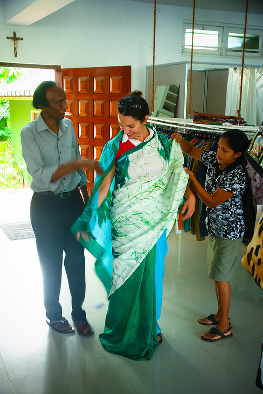 Joy trying on a sari batiked by Erik