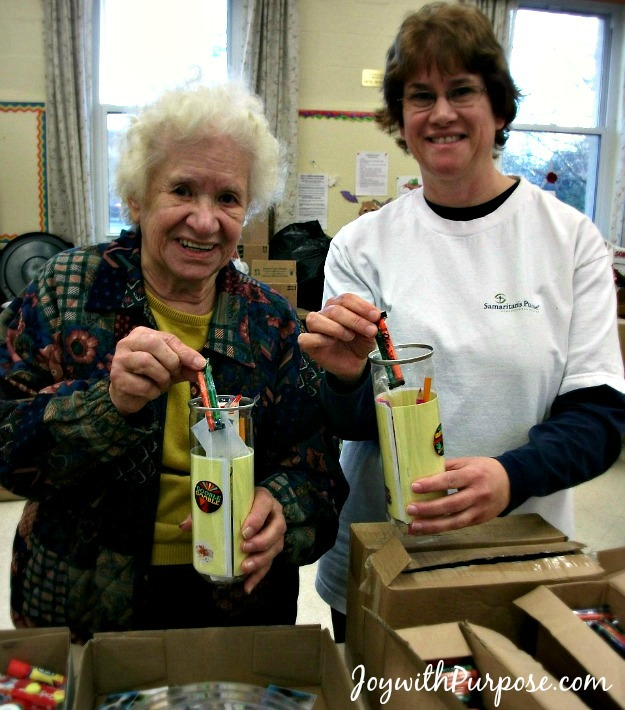 From our packing party to fill our salvaged tennis ball containers. We packed them with school supplies, hygiene items and toys then into our Operation Christmas Child shoebox gifts.