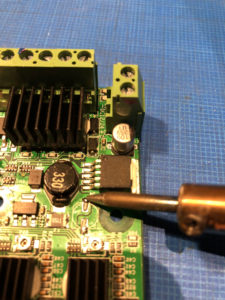 Prepare the solder pads for the new C4 capacitor