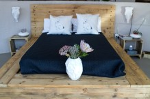 Wooden Bed with Navy Linen