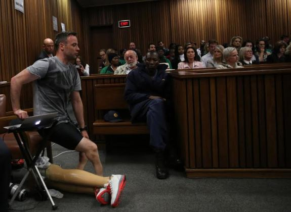 Paralympic gold medalist Oscar Pistorius prepares to walk across the courtroom without his prosthetic legs during the third day of his hearing at the Pretoria High Court for sentencing procedures in his murder trial in Pretoria on June 15, 2016. The final witness was due to appear at Oscar Pistorius's sentencing hearing on June 15 as the paralympic athlete awaits a new jail term for murdering his girlfriend Reeva Steenkamp three years ago. / AFP PHOTO / POOL AND AFP PHOTO / SIPHIWE SIBEKOSIPHIWE SIBEKO/AFP/Getty Images
