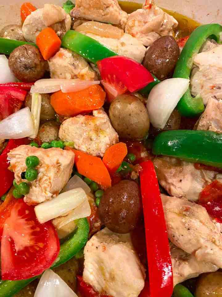 Cooked Chicken Afritada with Bell Peppers, Tomatoes, Onions, Carrots, Potatoes