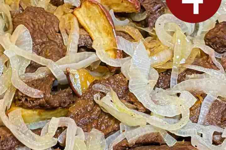 Sautéed beef with fried potato wedges and caramelized sliced onions