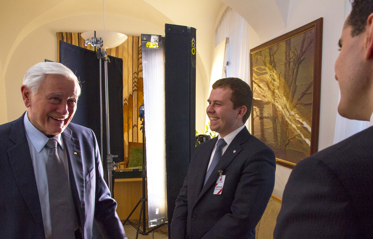 Producers David Naglieri and Szymon Czyszek chat with former Lithuanian President Valdus Adamkus in his office at the Presidential Palace in Vilnius.
