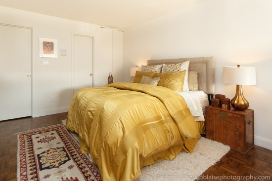 Apartment photography of a yellow bed, in a one bedroom duplex in midtown New York