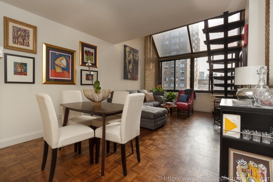 Apartment photographer work, midtown apartment, view of the living room and the large window, new york city