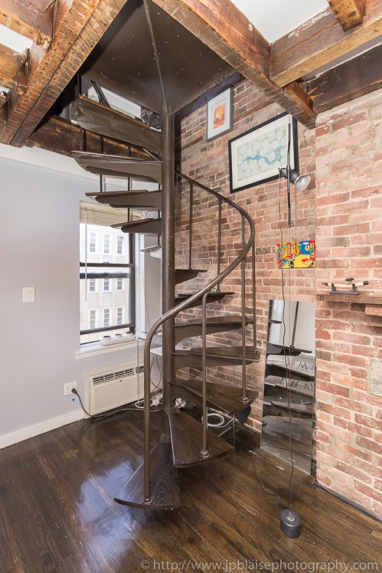 Staircase leading to top floor of One Bedroom apartment in the East Village of New York City