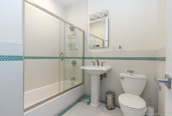 Interior photographer work bathroom of one bedroom apartment in Harlem
