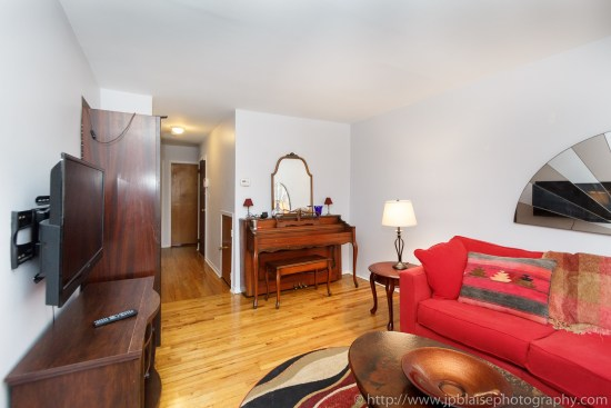 Real Estate Photographer photosession two bedoom apartment in sunnyside queens photo of living room with piano