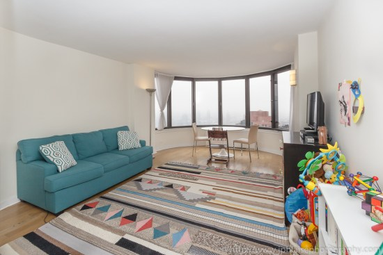 Real Estate photographer: living room of Midtown east unit new york with east river views
