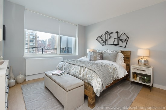 Real estate photographer: picture of the bedroom of a Midtown west one bedroom apartment, new york